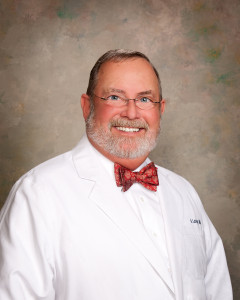 Richard Levacy head and shoulders portrait wearing white lab coat.